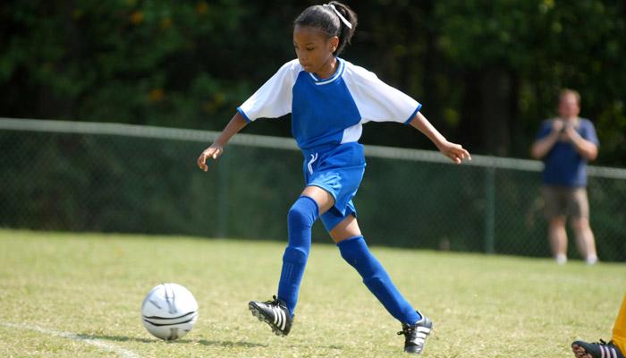 teen girl playing soccer