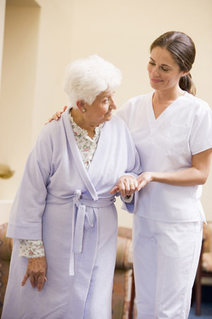 nurse assisting elderly patient