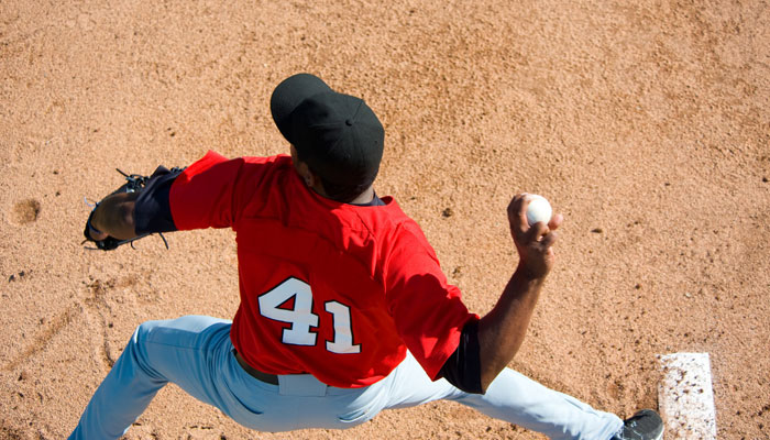 baseball player throwing with right hand