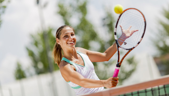 teen girl playing tennis
