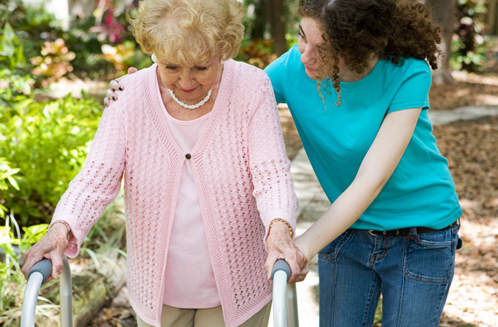 daughter helping elderly mother