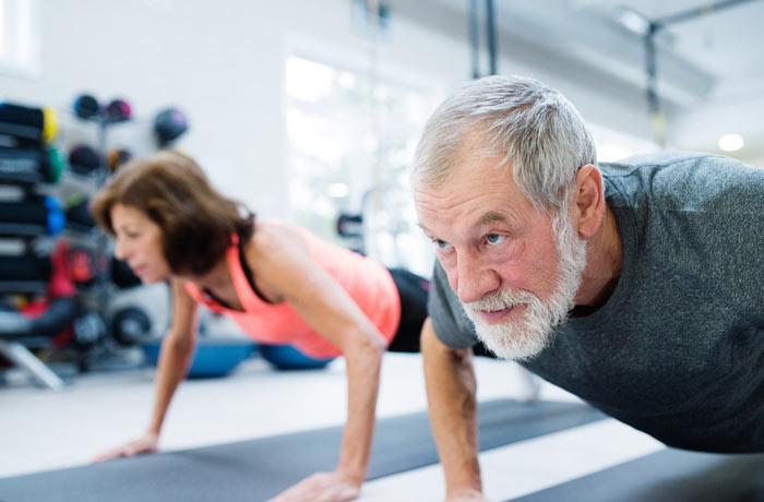 elderly man doing push up exercises