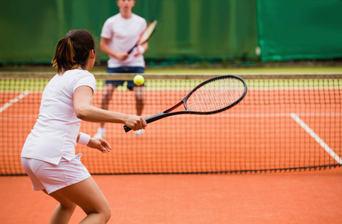 young adult athletes playing tennis
