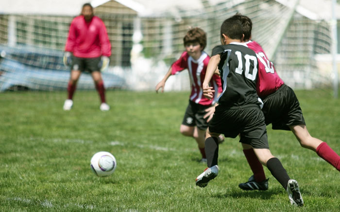 young boys soccer teams playing game