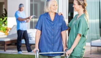 nurse encouraging patient after hip surgery