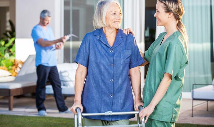 nurse encouraging patient after hip surgery