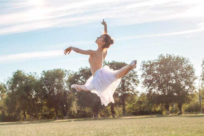 dancing gracefully in grassy field