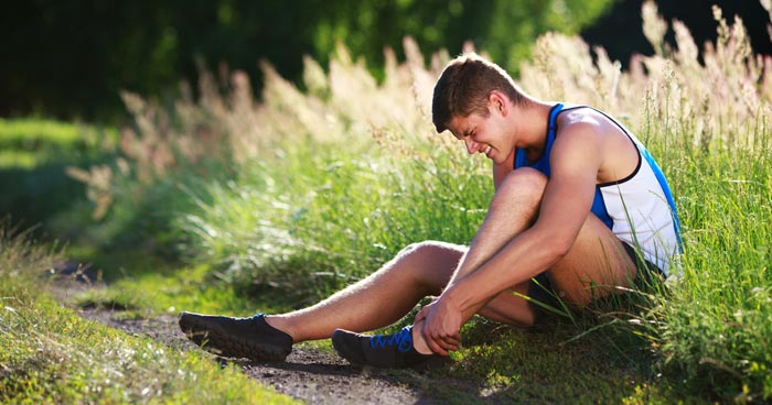 jogger in pain after spraining ankle