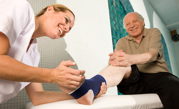 physical therapist helping hurt foot
